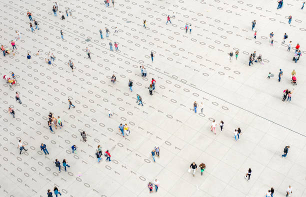 Crowd walking over binary code stock photo