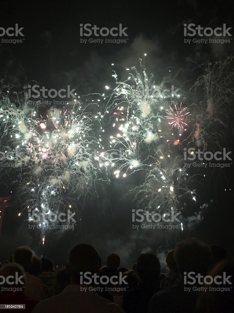 Crowd watches fireworks at anniversary event stock photo