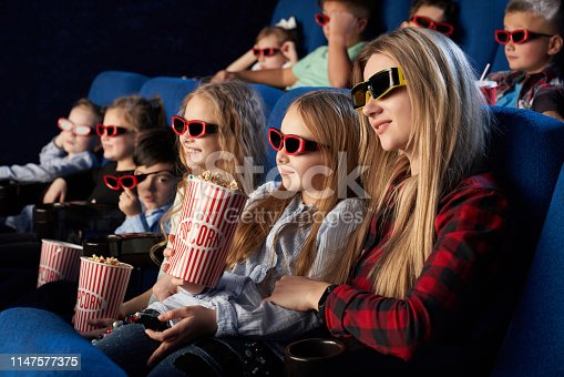 istock Crowd watching 3D movie in theatre. 1147577375