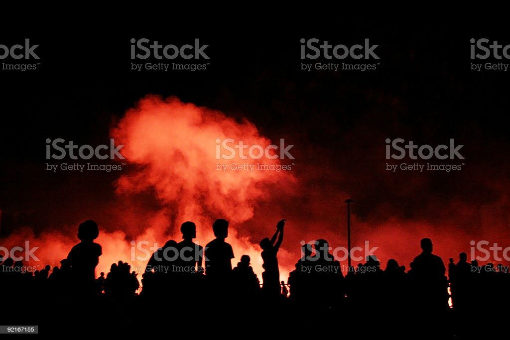 Crowd watching explosions stock photo