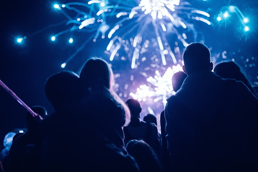 Crowd Watching Fireworks And Celebrating New Year Eve Stock Photo - Download Image Now