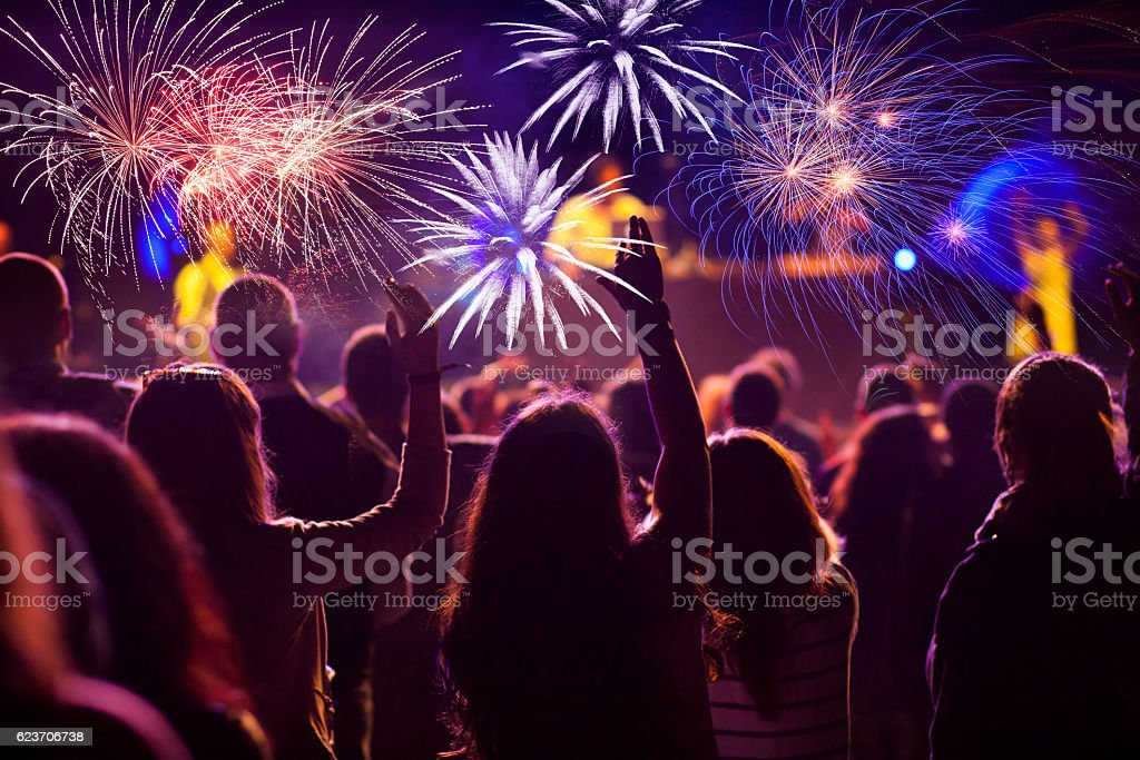 Crowd watching fireworks at New Year stock photo