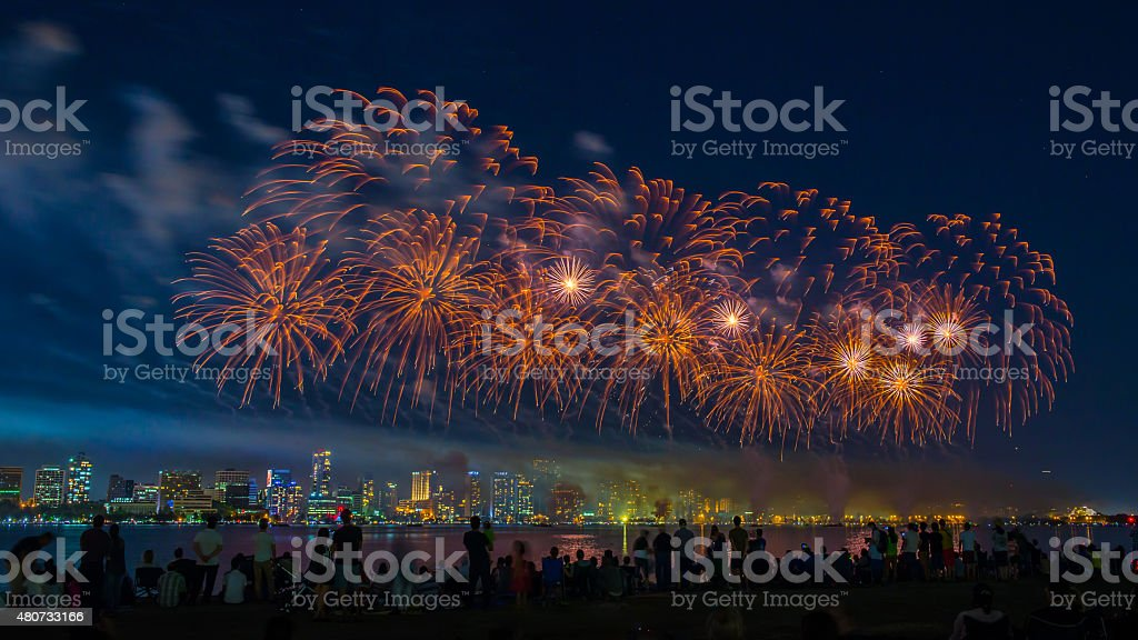 Crowd Watching Fireworks Display Over the River stock photo