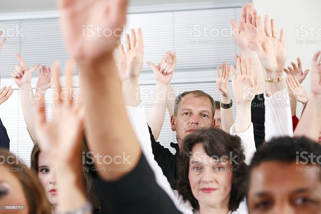 Crowd with hands in the air royalty-free stock photo