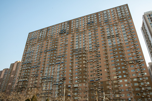 Crowded apartment building in Beijing, China, dense windows