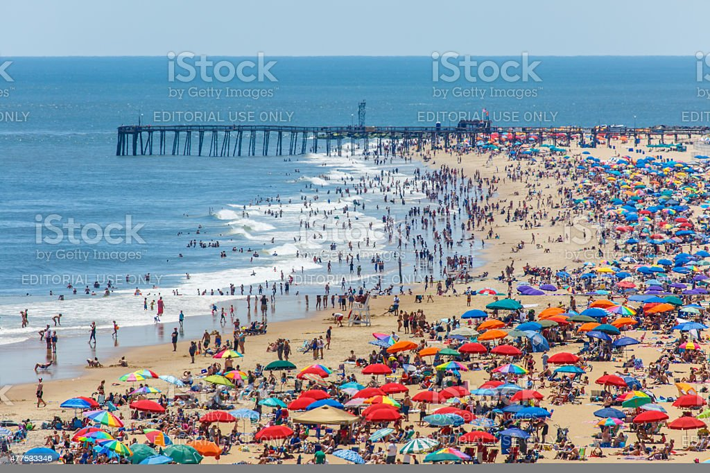 Crowded beach covered with umbrellas in Ocean City, MD stock photo