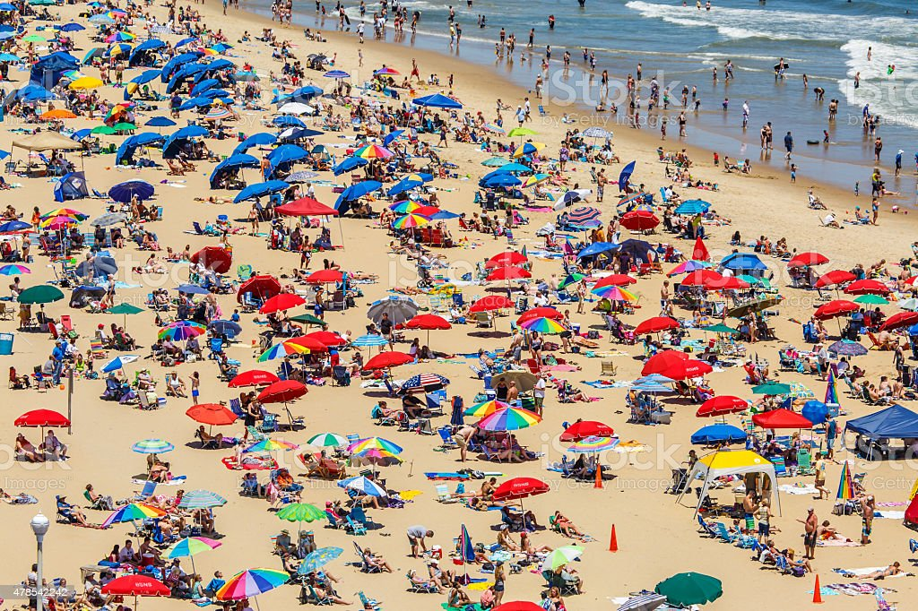 Crowded beach covered with umbrellas stock photo