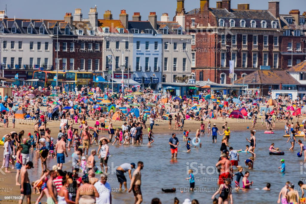 crowded beach sunny hot bank holiday vacation sea stock photo