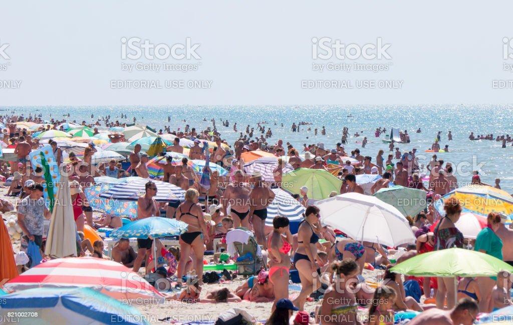 Crowded Black Sea summer beach in Primorske, Ukraine stock photo