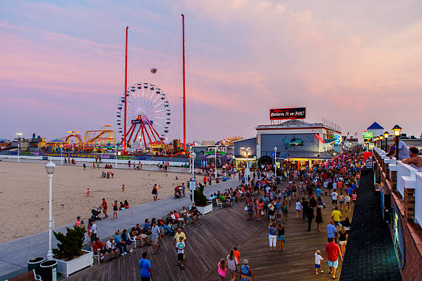 Crowded boardwalk in Ocean City, MD Ocean City, USA - August 4, 2014: Crowded boardwalk in Ocean City, MD on August 4, 2014. National Geographic named it one of the top 10 boardwalks in USA and The Travel Channel called it America's best. boardwalk stock pictures, royalty-free photos & images