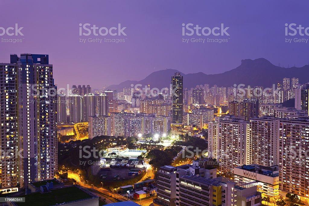 Crowded buildings at night in Hong Kong royalty-free stock photo