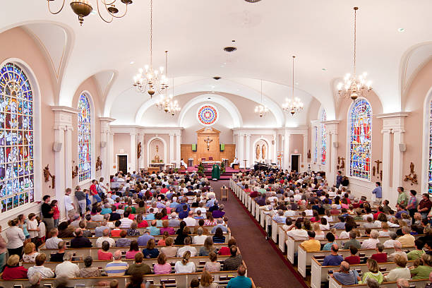 crowded church - church stock photos and pictures