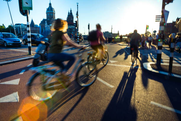 Crowded city street cyclists and pedestrians stock photo