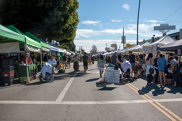 Crowded Farmers Market Crowded Farmers Market during a sunny day in southern California. farmer's market stock pictures, royalty-free photos & images