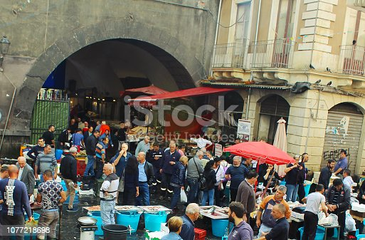 crowd at the pubic fish market of Catania
