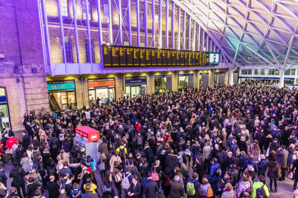 Crowded Kings Cross station in London stock photo