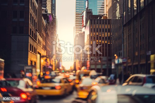 Yellow cabs iare rushing trough the city in the sunset time. Manhattan, New York City, US.