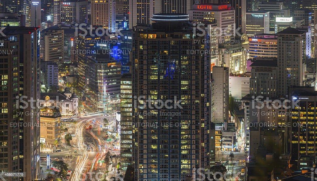 Crowded neon cityscape illuminated skyscrapers and rushing traffic Seoul Korea royalty-free stock photo
