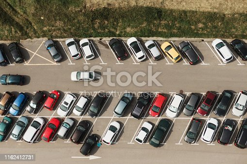 istock Crowded parking lot 1162412731