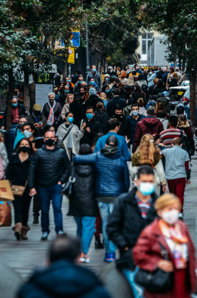 Crowded pedestrian street in Madrid, Spain stock photo