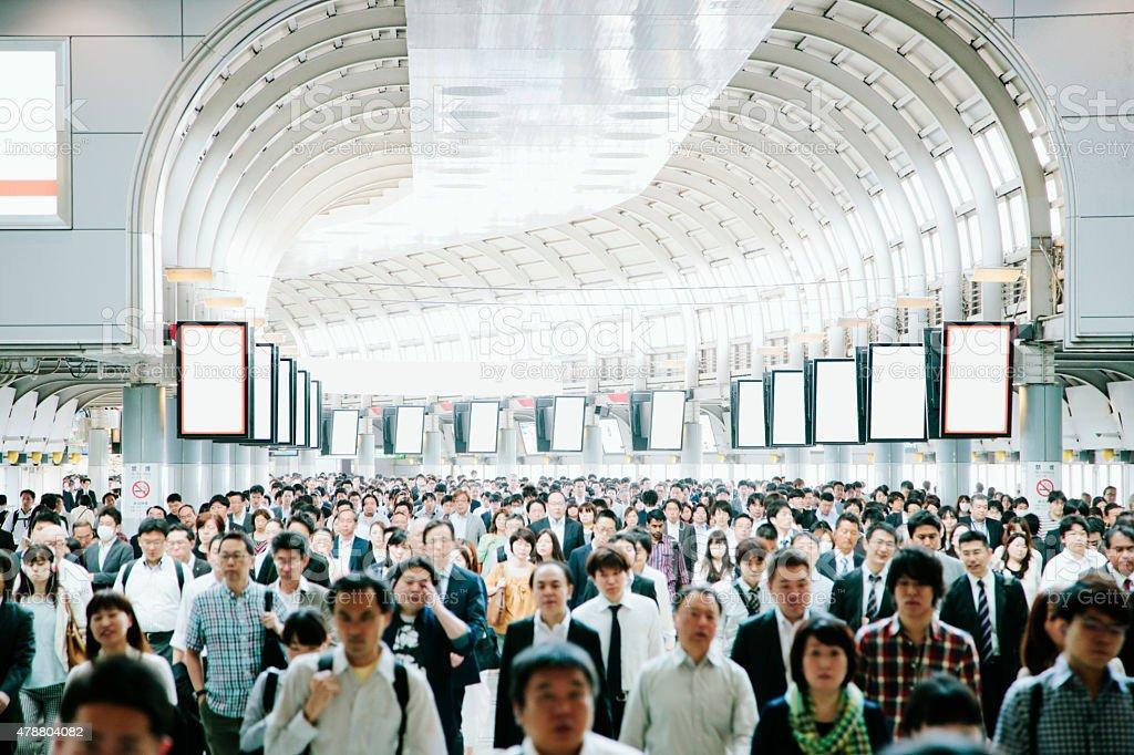Crowded pedestrian walkway, business people, Tokyo stock photo