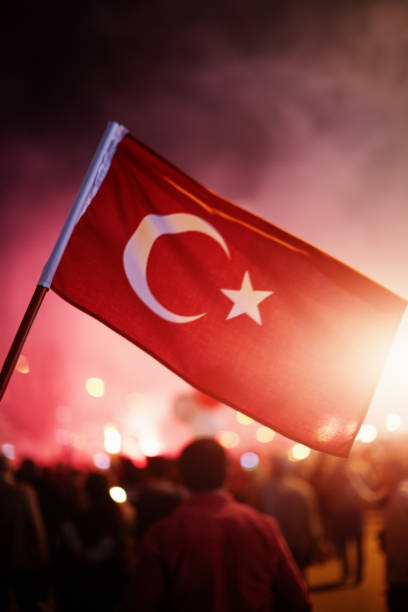 Crowded people celebrating or protest with Turkish flags in hand stock photo
