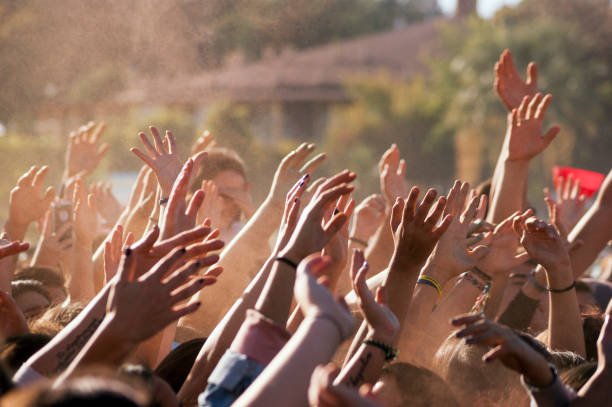 crowded people hands up - protestor stock pictures, royalty-free photos & images