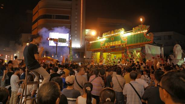 Crowded people in performing stage during Hungry Ghost Festival, Taiwan stock photo