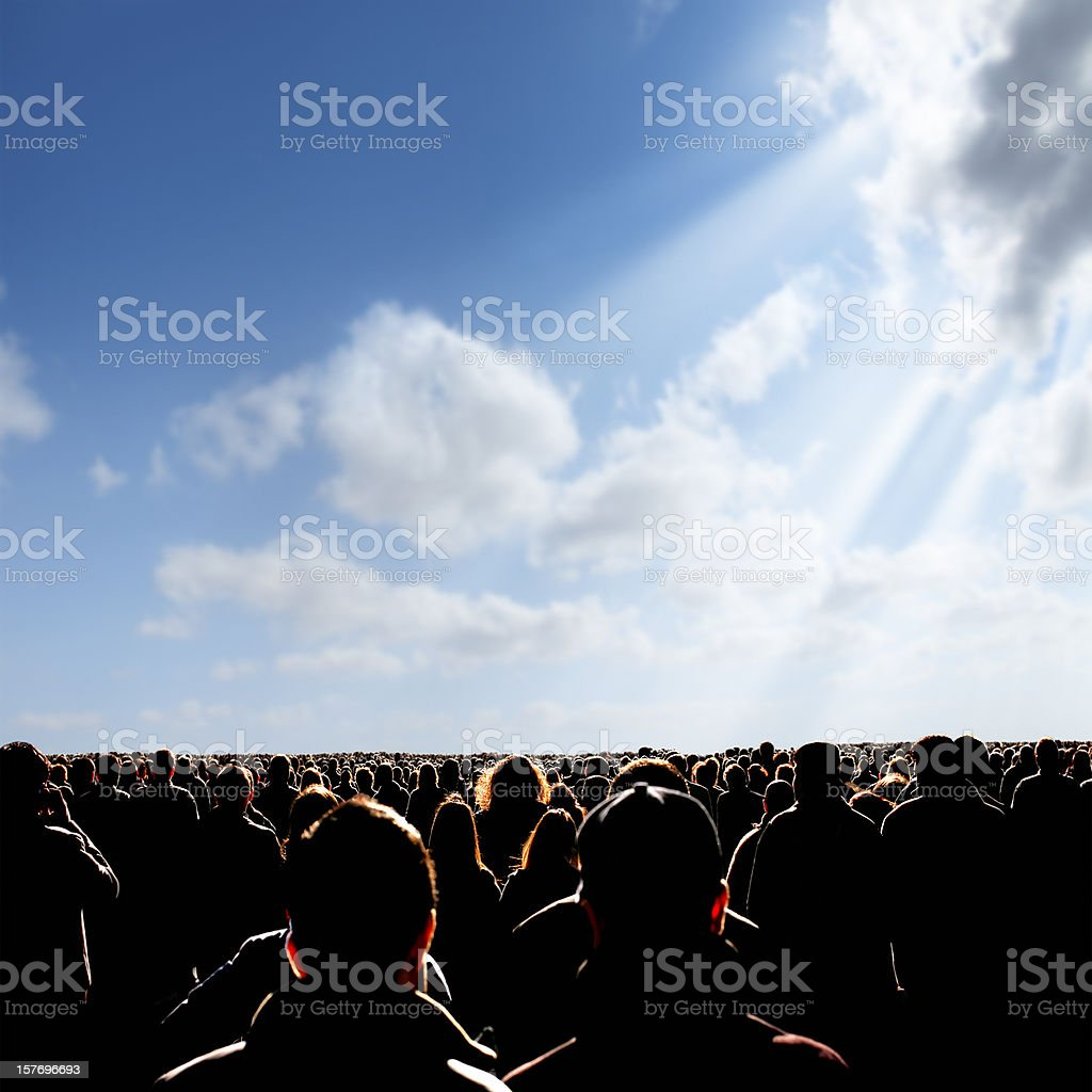 crowded people over sunny sky stock photo