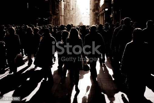 istock crowded people walking on busy street 125142692