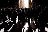 crowded people walking on busy street
