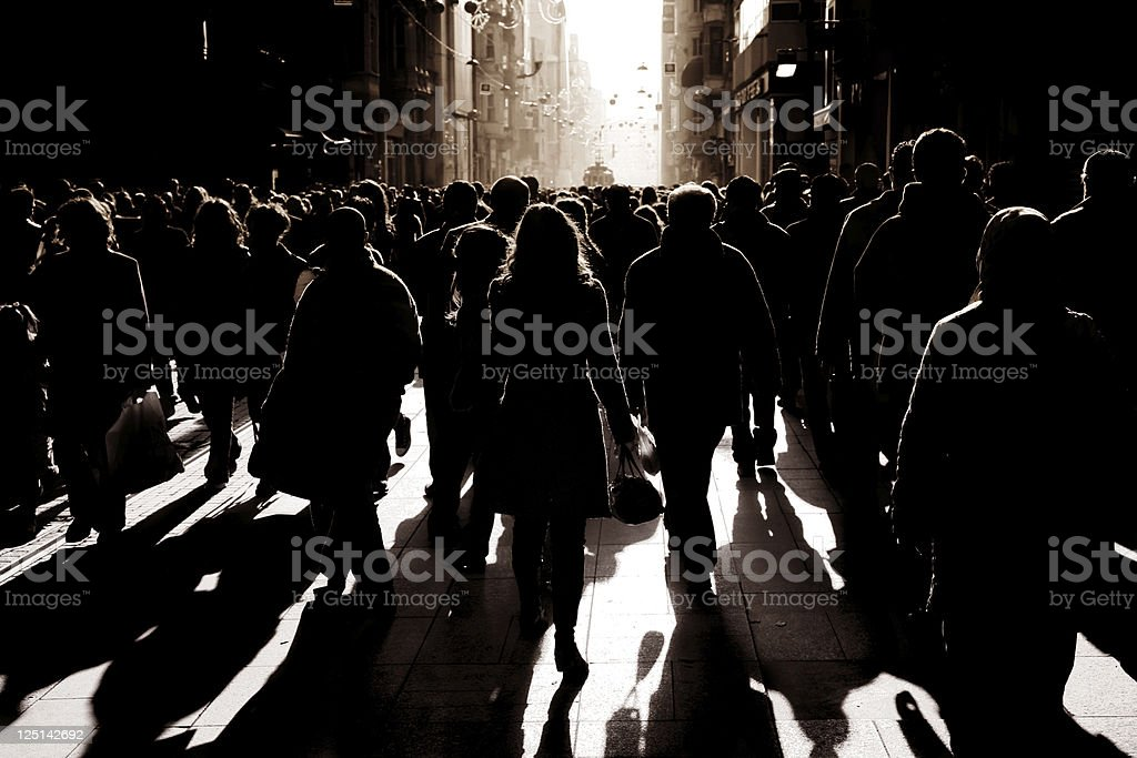 crowded people walking on busy street stock photo
