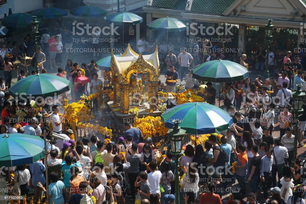 Crowded people worship to Brahma at Ratchaprasong district, Bangkok, Thailand on 1 January 2018. stock photo