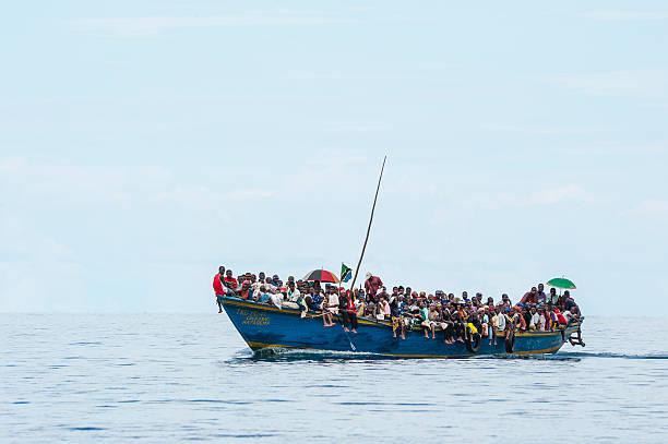 Crowded refugee boat on Lake Tanganyika stock photo