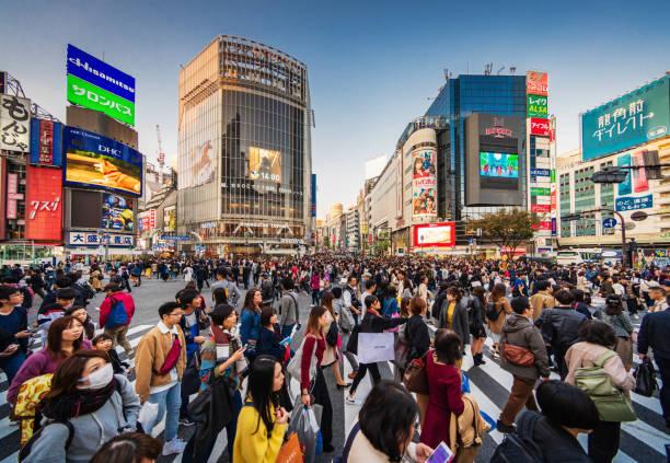 Crowded Shibuya Crossing Tokyo Japan stock photo