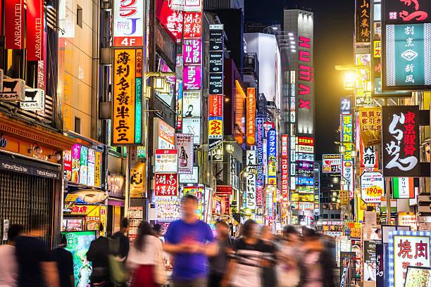 crowded shinjuku shopping district in tokyo, japan - shinjuku ward stock photos and pictures