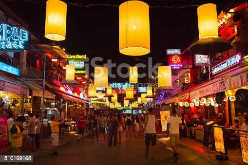 Siem Reap, Cambodia - January 5, 2016: Crowd of Tourists, Backpackers and Travellers walking along the famous illuminated downtown Pub Street packed with Bars, Hotels, Restaurant and Shops at Night. Pub Street Nightlife, Siem Reap, Cambodia.