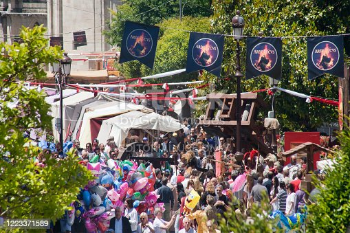 Lugo, Spain - June 16,2019: Crowded street, view from above in downtown Lugo,Lugo province, Galicia, Spain. Pedestrian commercial street, market stalls, feast decorations and people walking during 'Arde Lucus' traditional festival, roman Historical reenactment
