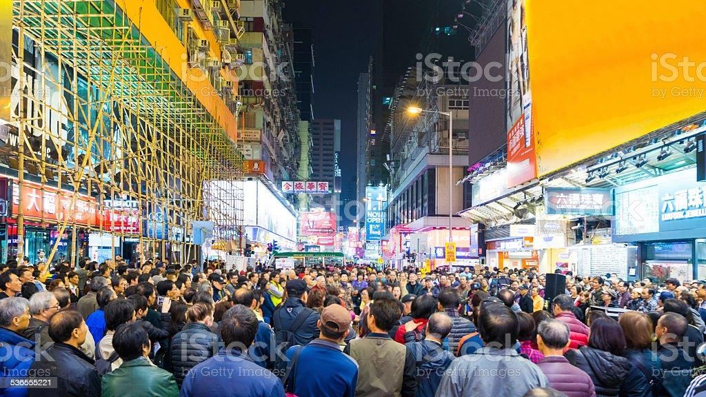 Crowded street in Hong Kong at night.