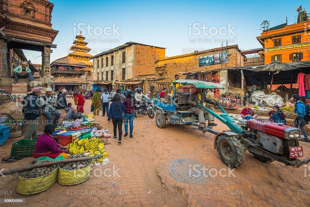 Crowded street market crumbling temples Bhaktapur Kathmandu Nepal stock photo