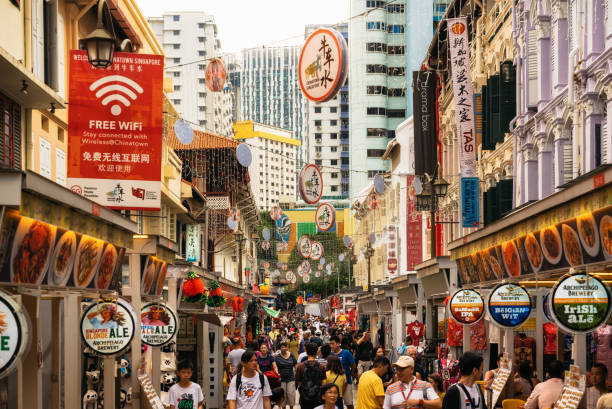 Crowded street with street food in Chinatown in Singapore stock photo