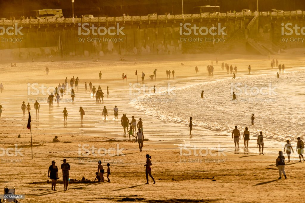 Crowded Summer Beach at sunset stock photo