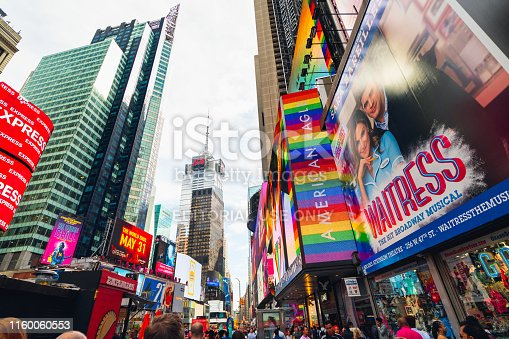981808424 istock photo Crowded Time Square, New York City. Skyscrapers, Billboards, Neon Art, Tourists, and Traffic 1160060553