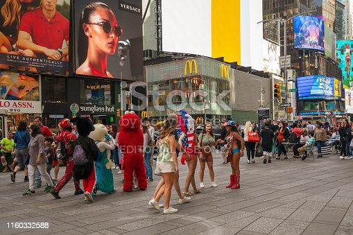 981808424 istock photo Crowded Times Square, New York City. Street View, Street Artists and Tourists, Neon Art, Billboards. 1160332588