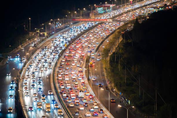 trafic encombré à beijing - embouteillage photos et images de collection