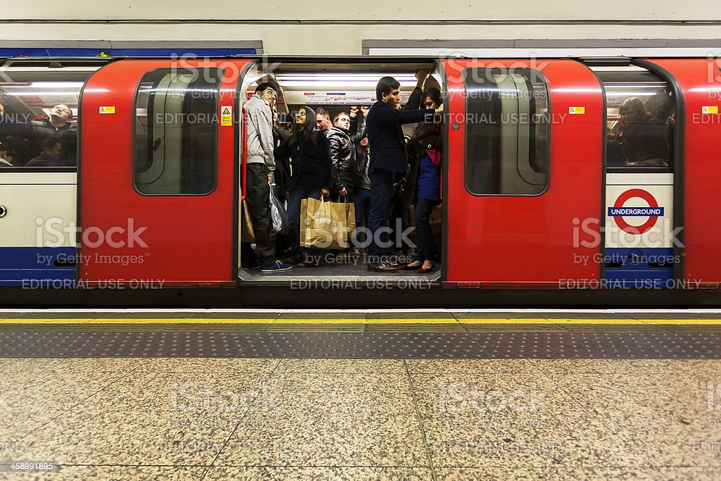 Crowded underground carriage stock photo