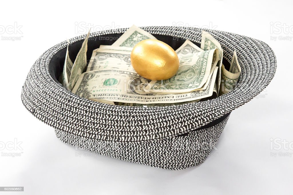 Crowdfunding hat with golden egg on top stock photo