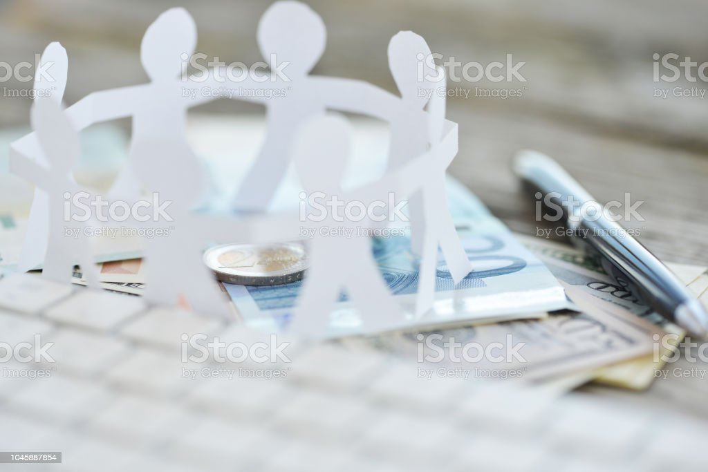 Crowdfunding or crowd investing concept with  circle human chain on cash money stock photo