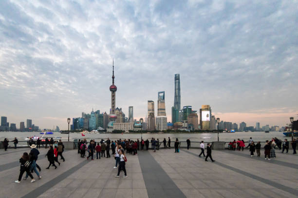 Crowds at the Bund with views of Shanghai, China stock photo