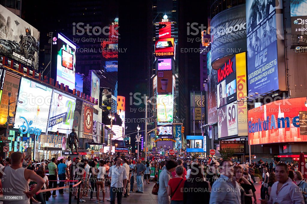 Crowds at Times Square in the night, NYC stock photo